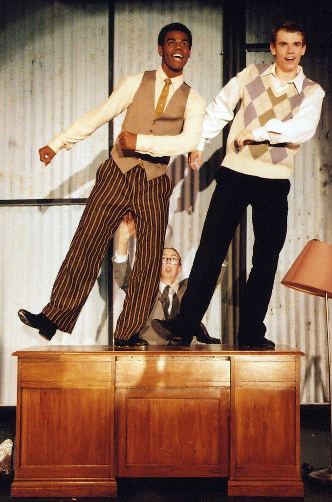 From left:  Ahmad Simmons and Jay Armstrong Johnson performing in Singin' in the Rain for their high school, Fort Worth Academy of Fine Arts in Fort Worth. Their performances earned them trophies for performance and choreography and the show won best musical at the Betty Buckley Awards for high school musical theater at Casa Manana Theatre in 2005.