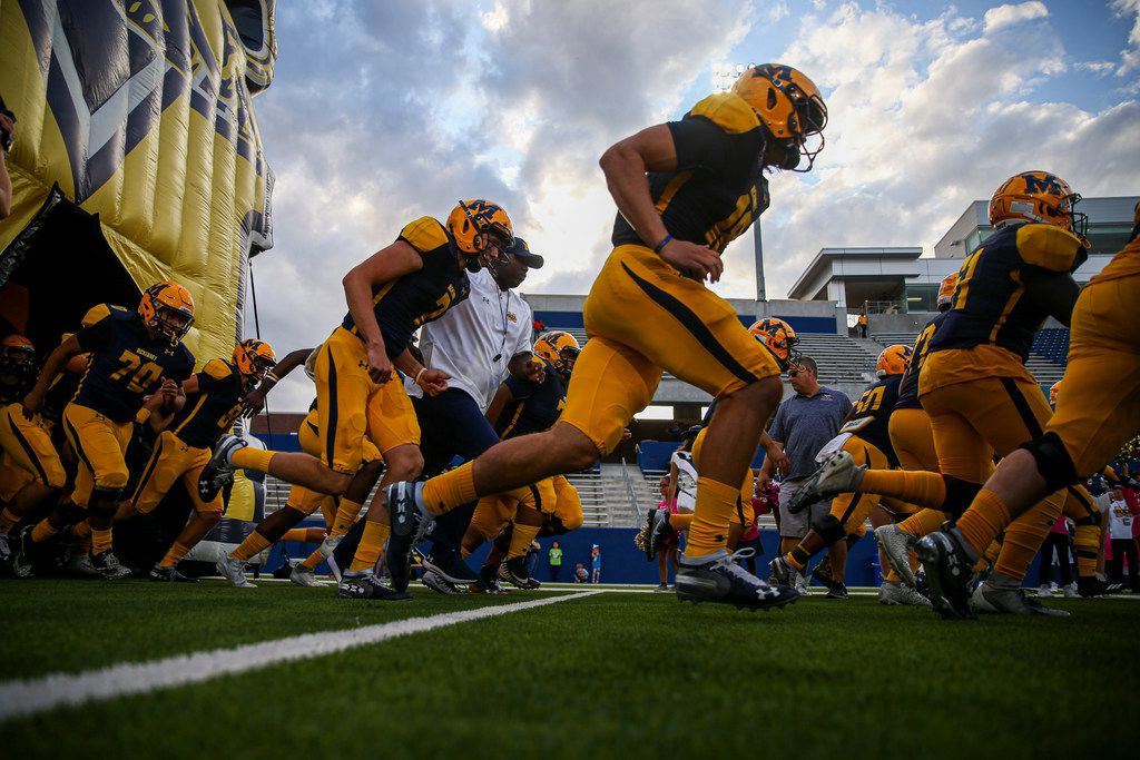 McKinney takes the field for their game against Plano high school on Thursday, October 10, 2019 at McKinney ISD Stadium in McKinney, Texas. (Shaban Athuman/Staff Photographer)