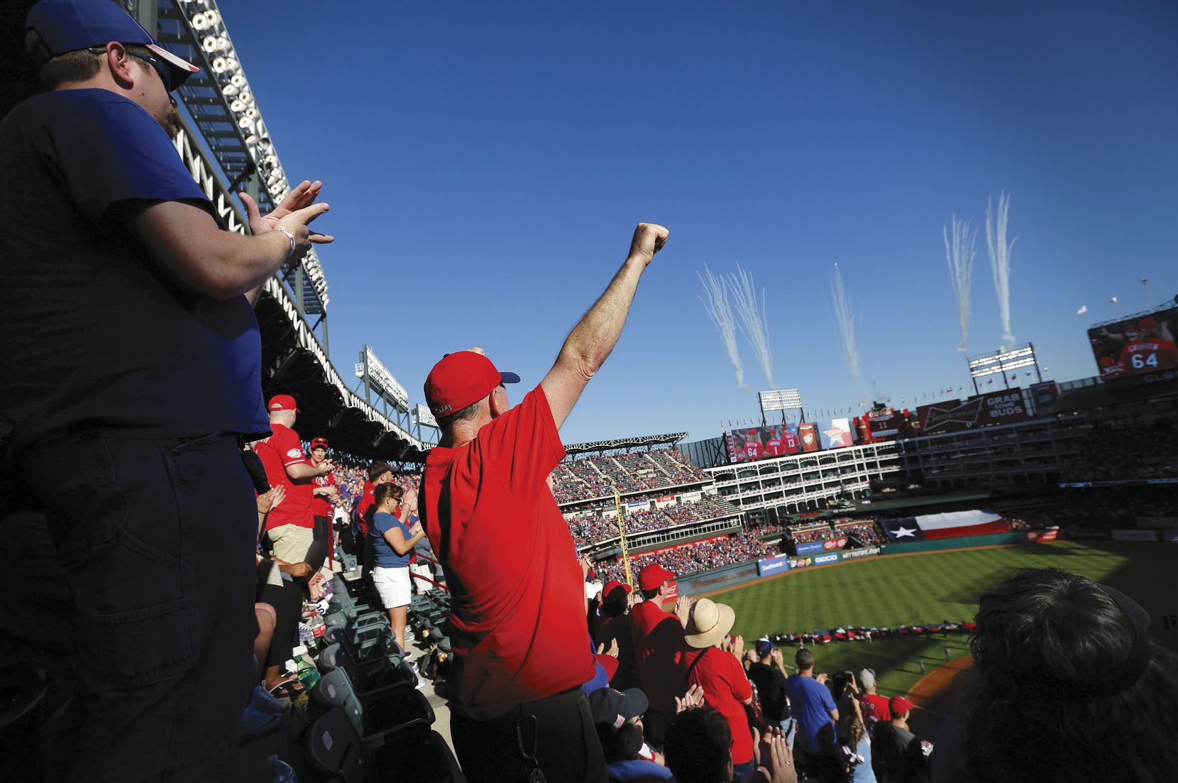 Fans and fireworks celebrate Opening Day for the Texas Rangers as the team takes on the Cleveland Indians at Globe Life Park in Arlington.