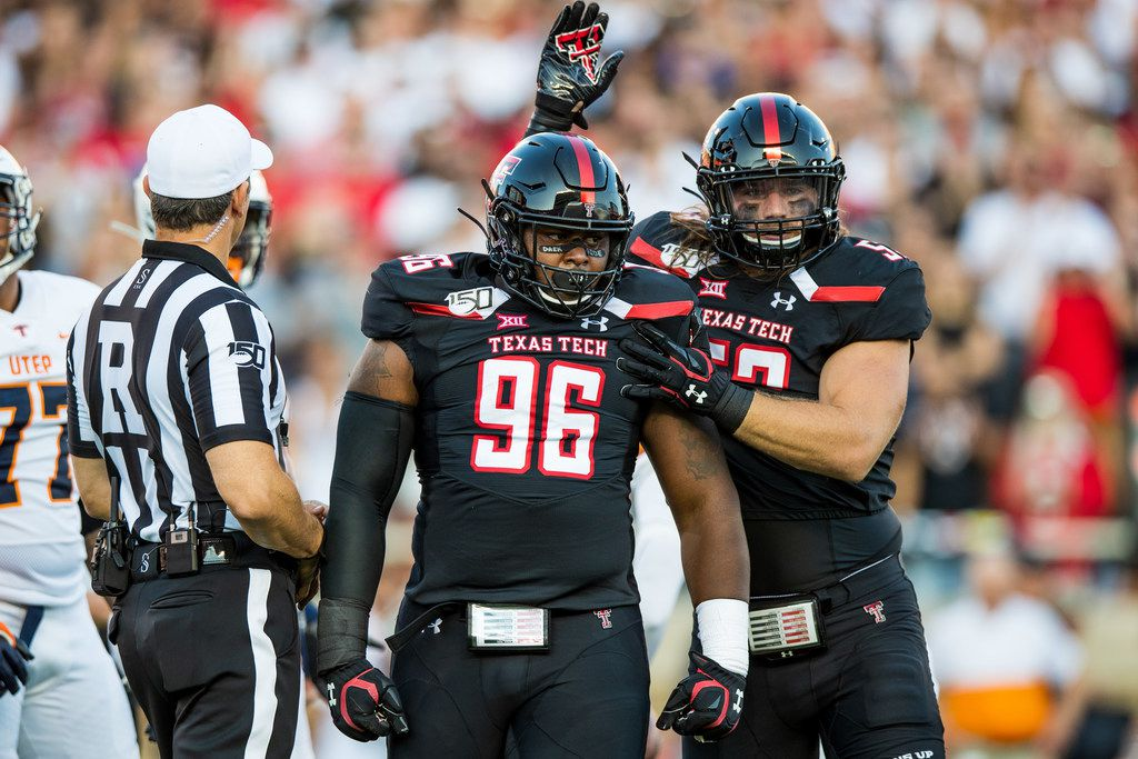 LUBBOCK, TEXAS - SEPTEMBER 07: Defensive lineman Broderick Washington Jr. #96 and defensive lineman Eli Howard V #53 of Texas Tech celebrate a tackle by Washington Jr. during the first half of the college football game between the Texas Tech Red Raiders and the UTEP Miners at Jones AT&T Stadium on September 07, 2019 in Lubbock, Texas. (Photo by John E. Moore III/Getty Images)