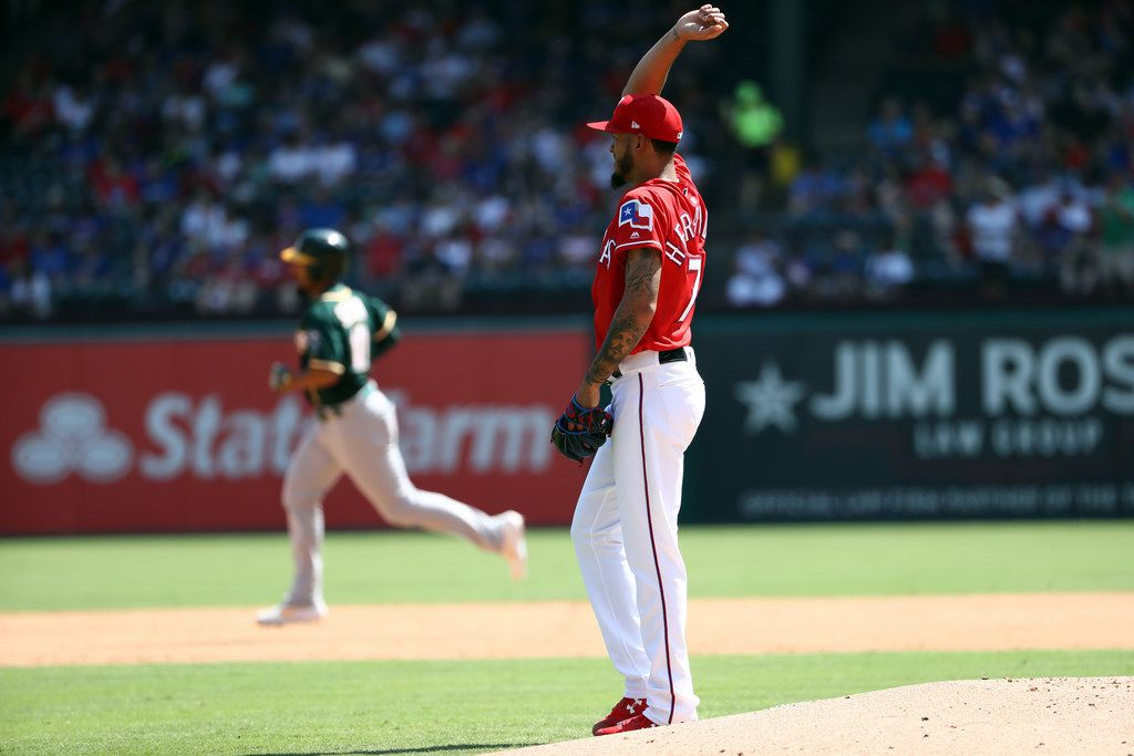ARLINGTON, TEXAS - SEPTEMBER 15:  Jonathan Hernandez #72 of the Texas Rangers steps off the mound after giving up a two-run homerun to Marcus Semien #10 of the Oakland Athletics in the third inning at Globe Life Park in Arlington on September 15, 2019 in Arlington, Texas.