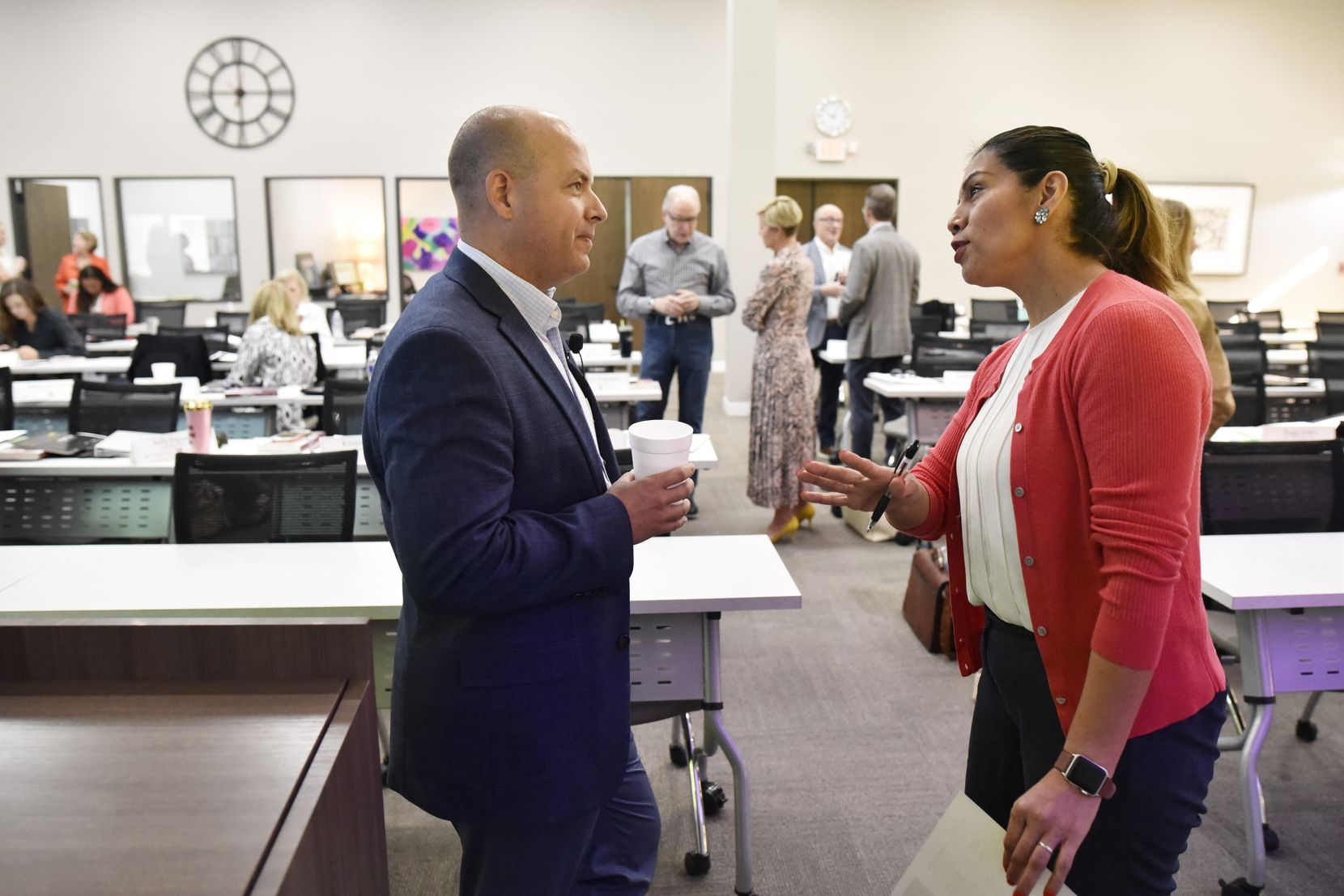 Sandra Diaz-Mills spoke with Ebby Halliday Cos. chief executive officer and president Chris Kelly during a break for new associate training at the Ebby Marketing and Education Center in September.