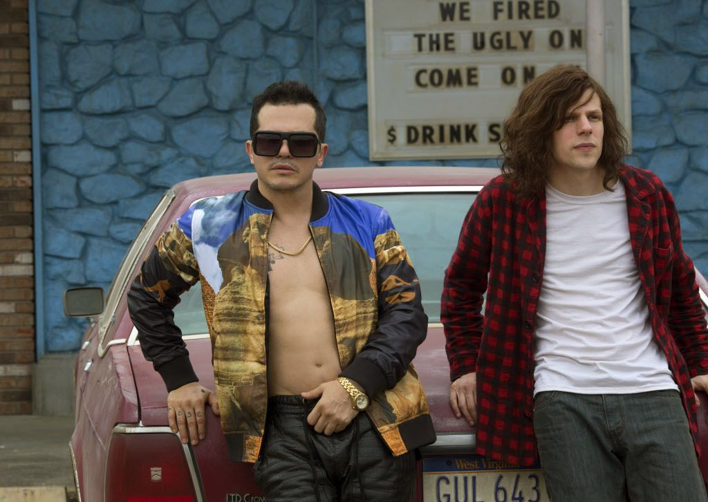 """In this image released by Lionsgate, John Leguizamo, left, and Jesse Eisenberg appear in a scene from """"American Ultra."""" (Alan Markfield/Lionsgate via AP)"""
