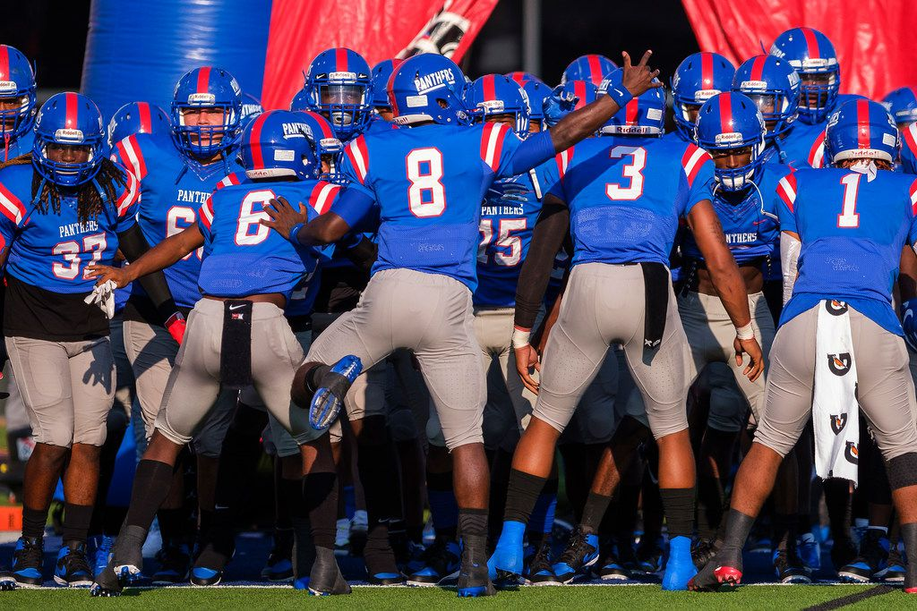 Duncanville players prepare to take the field to face St. John's College (D.C.) in a high school football game on Saturday, Sept. 14, 2019, in Duncanville. (Smiley N. Pool/The Dallas Morning News)