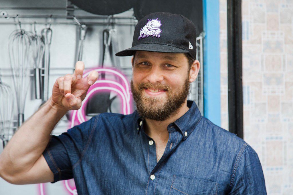 """Broadway veteran Ben Thompson, an alumnus of Texas Christian University in Fort Worth, makes TCU's signature """"horned frogs"""" sign at the Brooks Atkinson Theatre on Broadway, where he plays Earl in Waitress."""