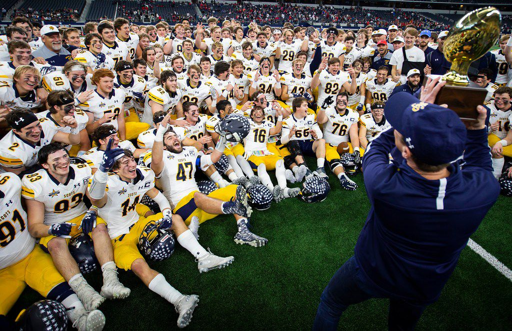 Highland Park players cheer as they are presented the game trophy following a 43-21 victory over Denton Ryan in a Class 5A Division I state semifinal at AT&T Stadium on Dec. 15, 2018, in Arlington. (Smiley N. Pool/The Dallas Morning News)