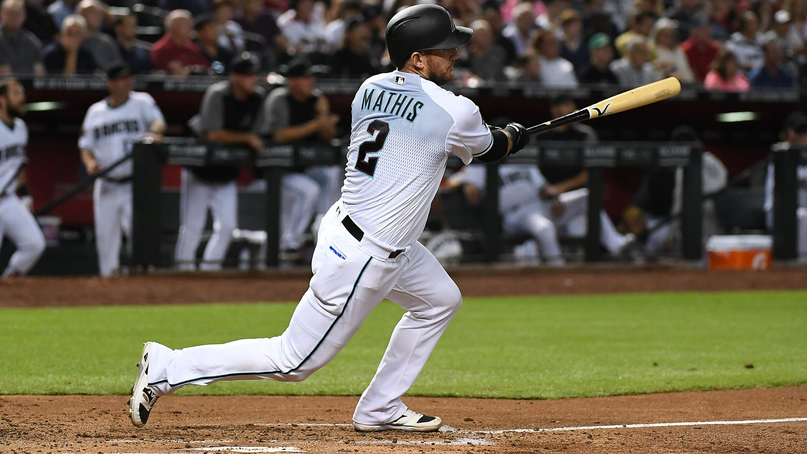 PHOENIX, AZ - SEPTEMBER 04:  Jeff Mathis #2 of the Arizona Diamondbacks follows through on a swing against the San Diego Padres at Chase Field on September 4, 2018 in Phoenix, Arizona.  (Photo by Norm Hall/Getty Images)