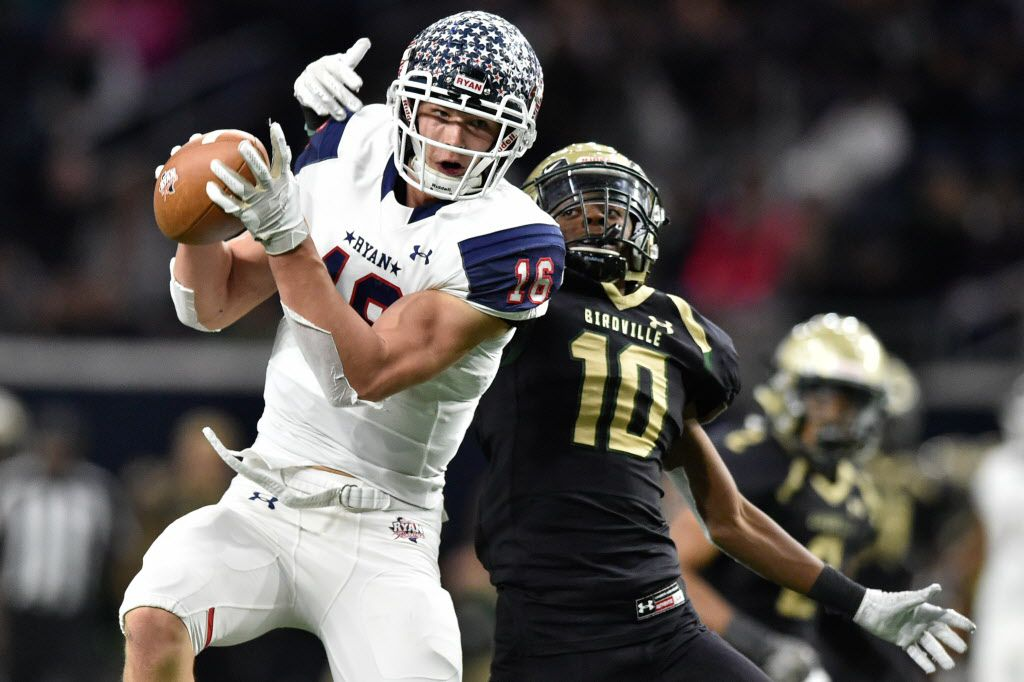 Denton Ryan-Birdville game. Ryan wide receiver Drew Sanders (16) catches a pass, while being defended by Birdville's Jalen Brown (10) at the Ford Center.