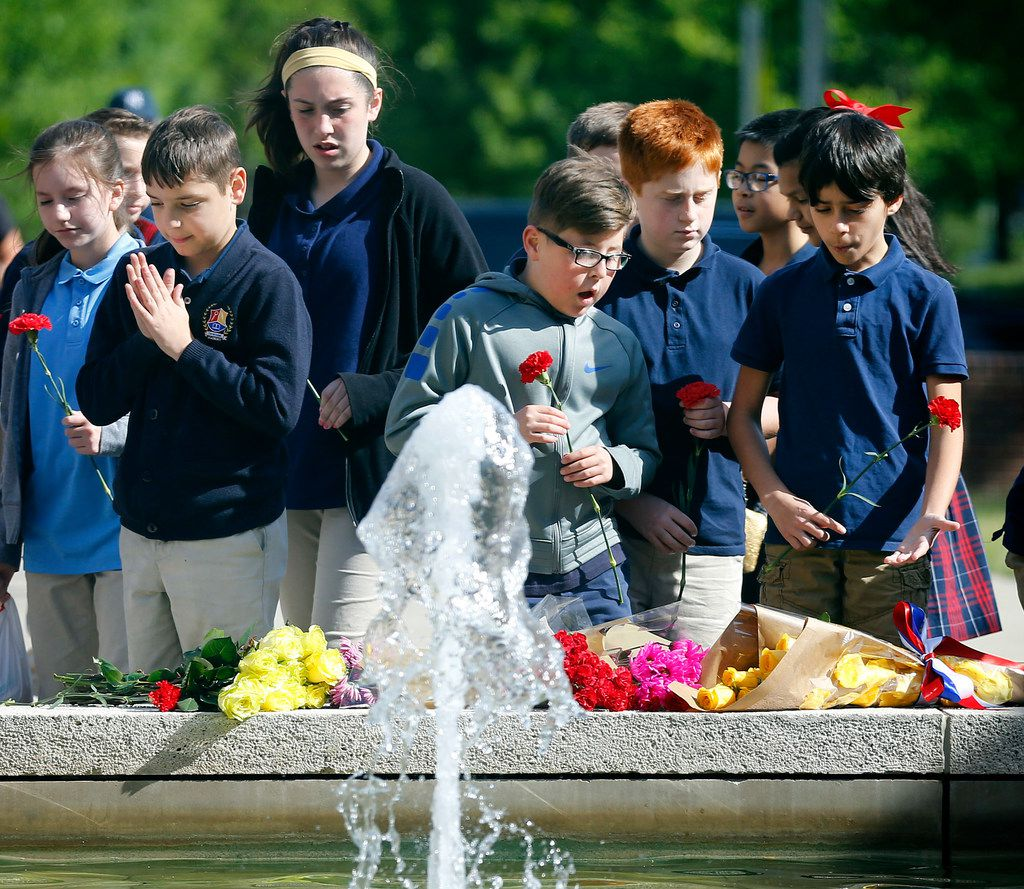 Schoolchildren from Trivium Academy in Carrollton leave flowers in memory of former first lady Barbara Bush at the George W. Bush Presidential Center. The school had a scheduled tour of the library and first ladies exhibit and thought it would be a appropriate to bring flowers for Mrs. Bush, who passed away Tuesday.