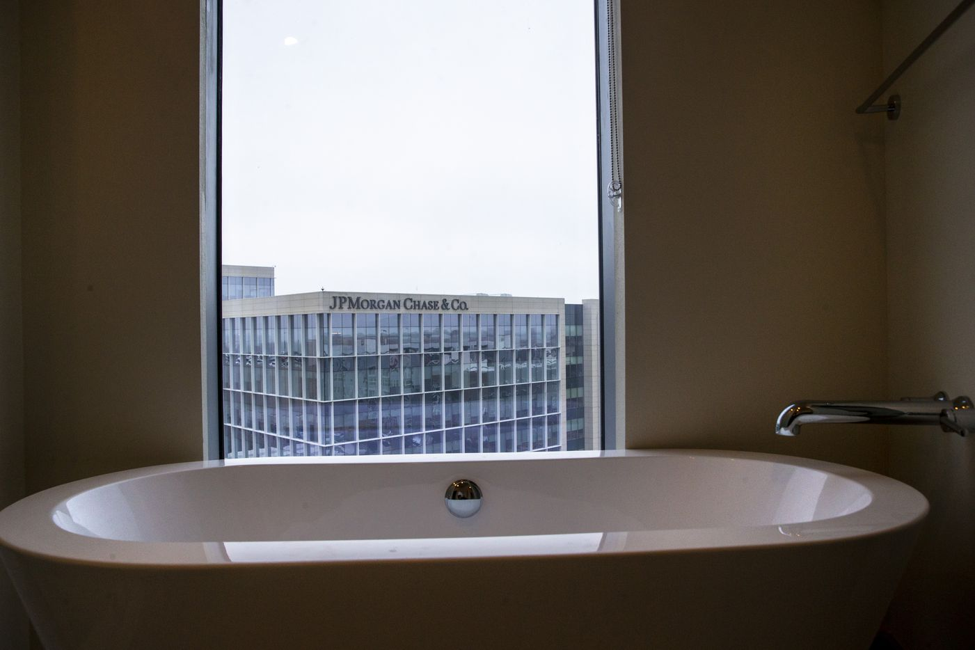 A bathtub in a two-bedroom unit at the new LVL 29 apartment high-rise looks out over the JPMorgan Chase offices.