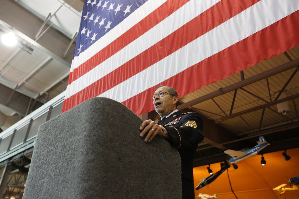 Command Sgt. Maj. Juan Hernandez speaks briefly at the Frontiers of Flight Museum during a news conference recognizing the grand marshals in this year's Greater Dallas Veterans Day Parade. Hernandez, who retired from active duty in 1994, is one of two grand marshals.