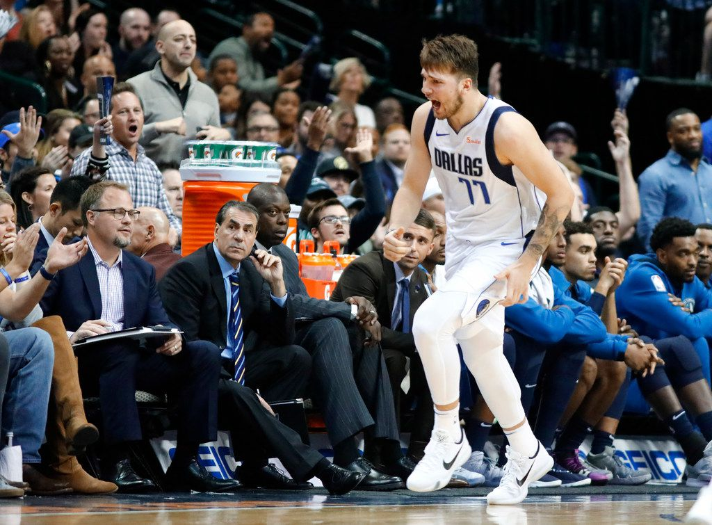 Dallas Mavericks guard Luka Doncic (77) celebrates his fourth quarter field goal in front of Minnesota Timberwolves bench in the fourth quarter at the American Airlines Center in Dallas, Saturday, October 20, 2018. (Tom Fox/The Dallas Morning News)