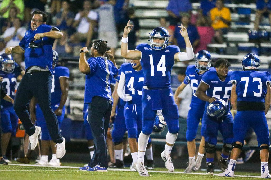 Nolan Catholic quarterback Jummy Taylor (14) celebrates after his team stopped Celina on a fourth down during a high schools football game at Doskocil Stadium in Fort Worth, TX on Friday, September 13, 2019. Nolan Catholic won 27-12. (Shaban Athuman/Staff Photographer)