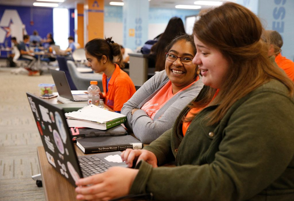 Crystal Ramirez (left), shares a laugh as she gets help from peer educator, Baleigh Zurn, at the University of Texas at Arlington in Arlington. The university's I.D.E.A.S. Center is designed with transfer students and other non-traditional students to help them through mentoring and tutoring as well as other services.