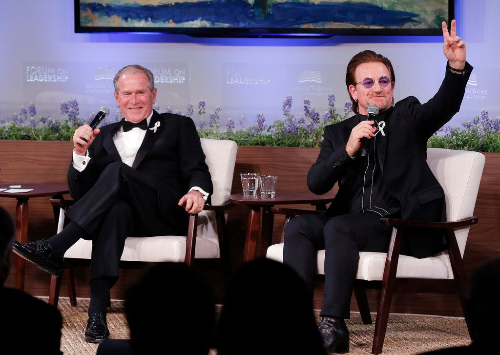 Former President George W. Bush, left, and U2 musician Bono participate in a Q&A session during a gala for the Forum on Leadership at the George W. Bush Institute, Thursday, April 19, 2018, in Dallas. President Bush presented Bono with a medal of Distinguished Citizenship. (AP Photo/Brandon Wade)