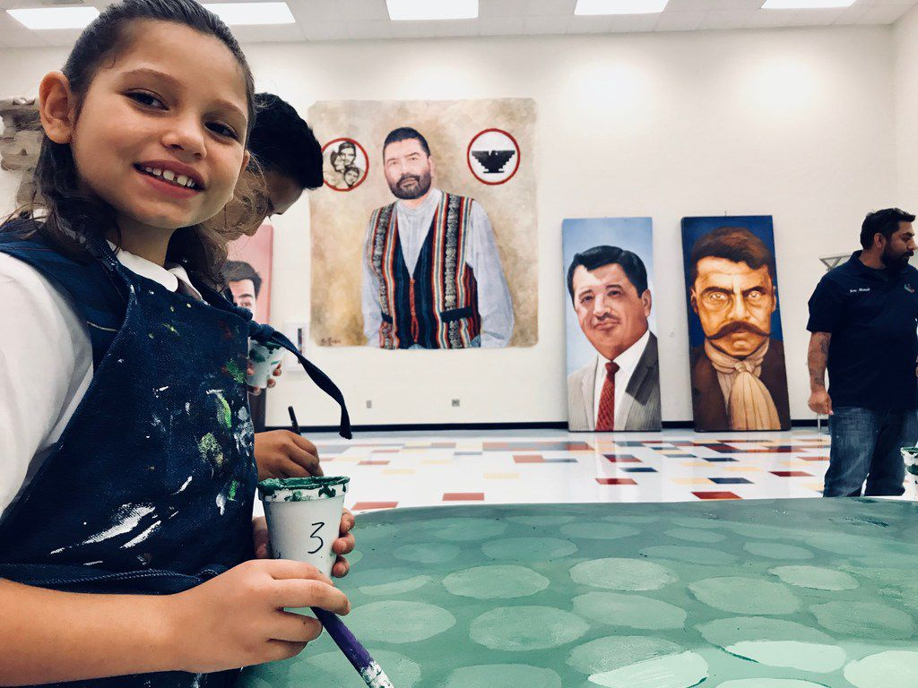 Azalae Custodio, 9, is one of the nine students who was working Wednesday, August 22 at La Fe Culture and Technology Center in El Paso on a mural to highlight animals and plants threatened by any future border wall. She says she is excited about sharing her love of the desert with others.