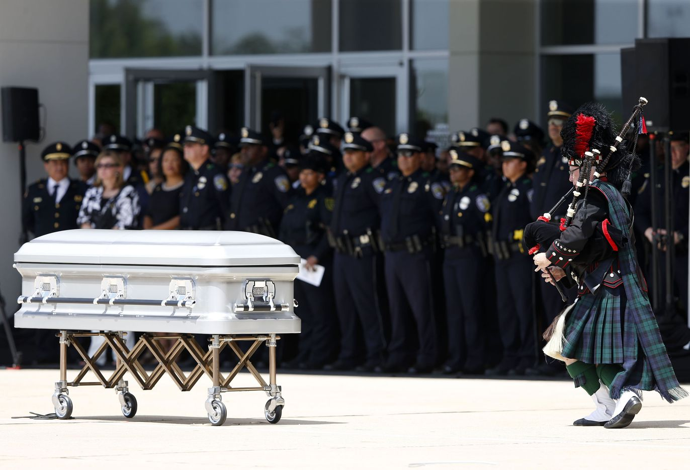 Bagpiper plays during a memorial service for DART Officer Brent Thompson at The Potter's House in Dallas on Wednesday, July 13, 2016. Thompson was one of five officers killed last week when a gunman opened fire during a Black Lives Matter rally in downtown Dallas.