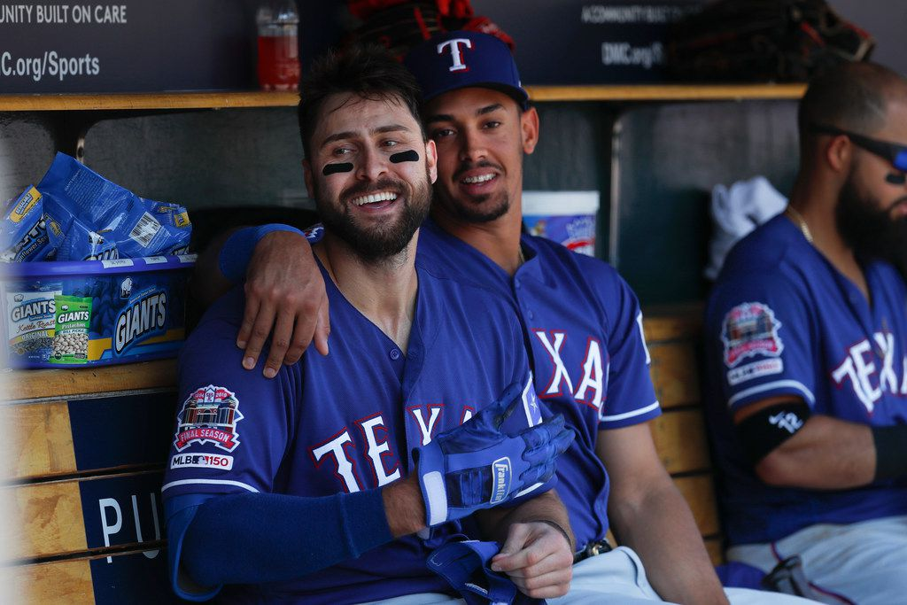Texas Rangers' Joey Gallo, left, celebrates his solo home run with Ronald Guzman in the fourth inning of a baseball game against the Detroit Tigers in Detroit, Thursday, June 27, 2019. (AP Photo/Paul Sancya)