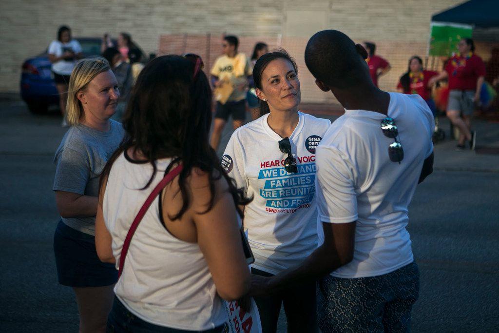 Congressional candidate Gina Ortiz Jones speaks with J.R. Jones before the annual Pride San Antonio festival parade June 30, 2018.