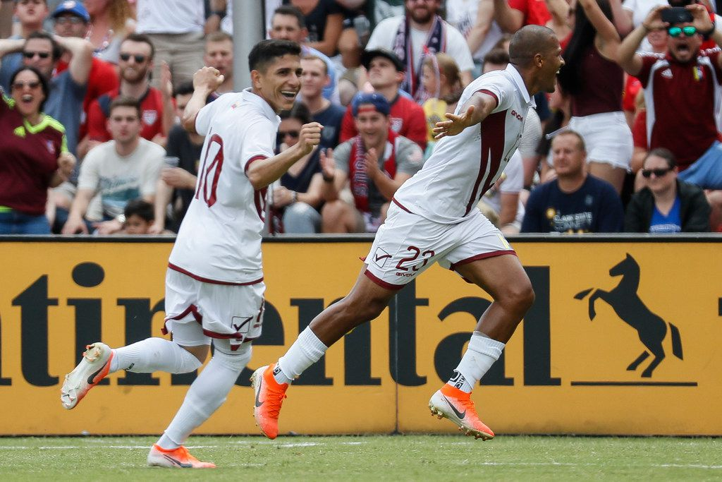 Venezuela forward Jose Salomon Rondon, right, celebrates his second goal with midfielder Jefferson Savarino (10) during the first half of an international friendly soccer match against the United States, Sunday, June 9, 2019, in Cincinnati. (AP Photo/John Minchillo)