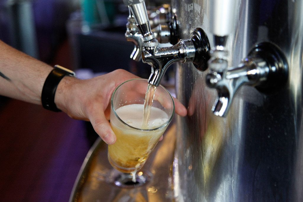 File photo of draft beer on tap.