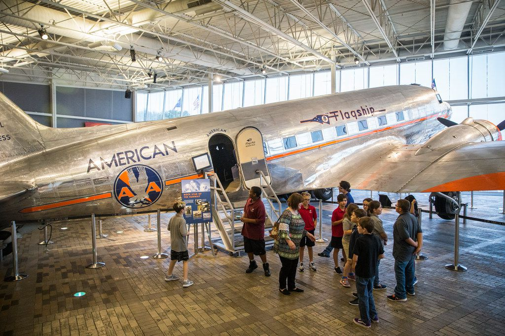 Students from Merryhill Elementary School in Arlington, Texas gather at the entrance of a Flagship Knoxville DC-3 during a tour of American Airlines C.R. Smith Museum on Thursday, August 23, 2018 in Fort Worth. The newly renovated museum reopens Labor Day Weekend. (Ryan Michalesko/The Dallas Morning News)