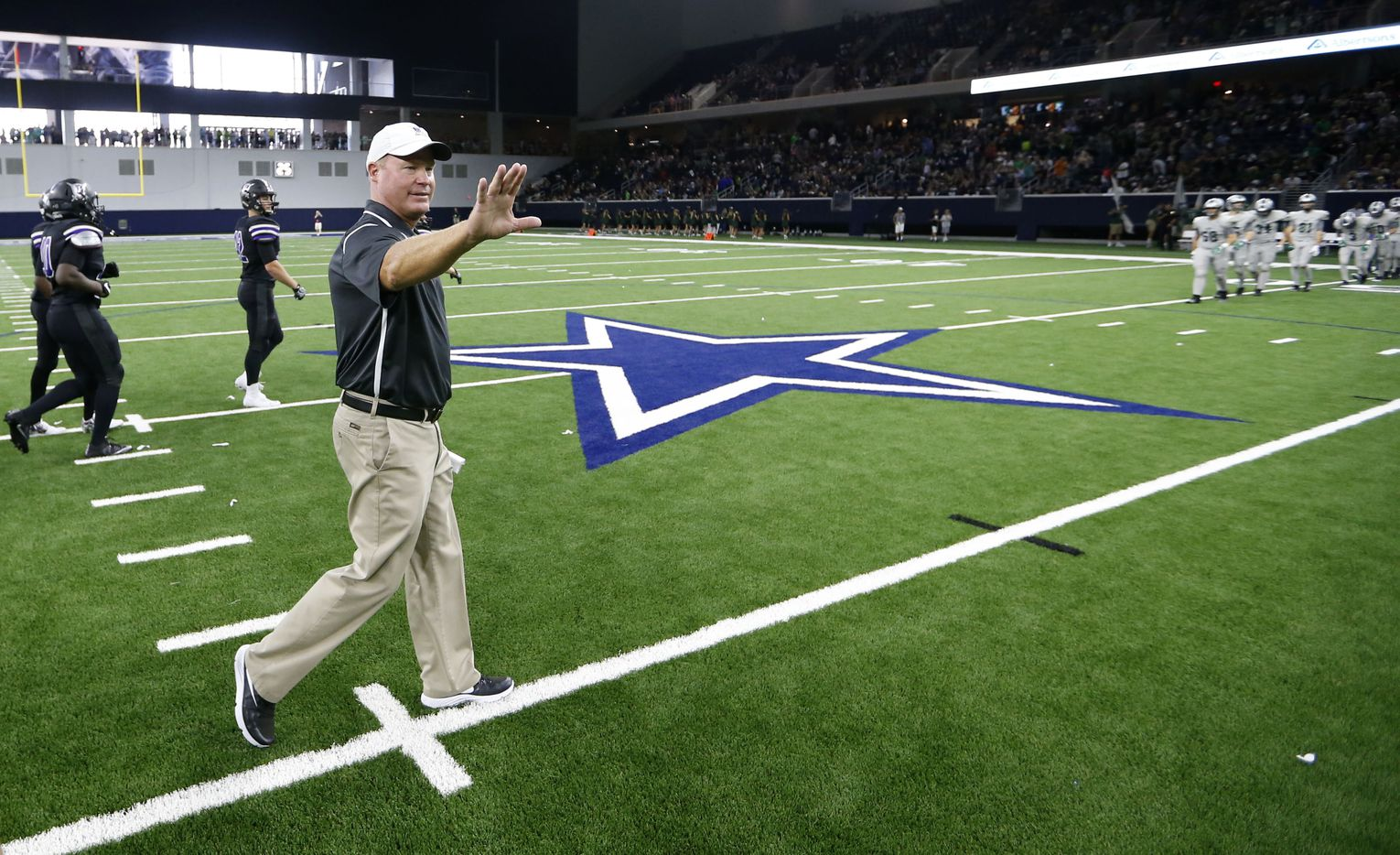 Independence High School head coach Kyle Story waves to the officials after defeating Reedy High School during the first high school football game at The Star in Frisco on Saturday, August 27, 2016. (Vernon Bryant/The Dallas Morning News)