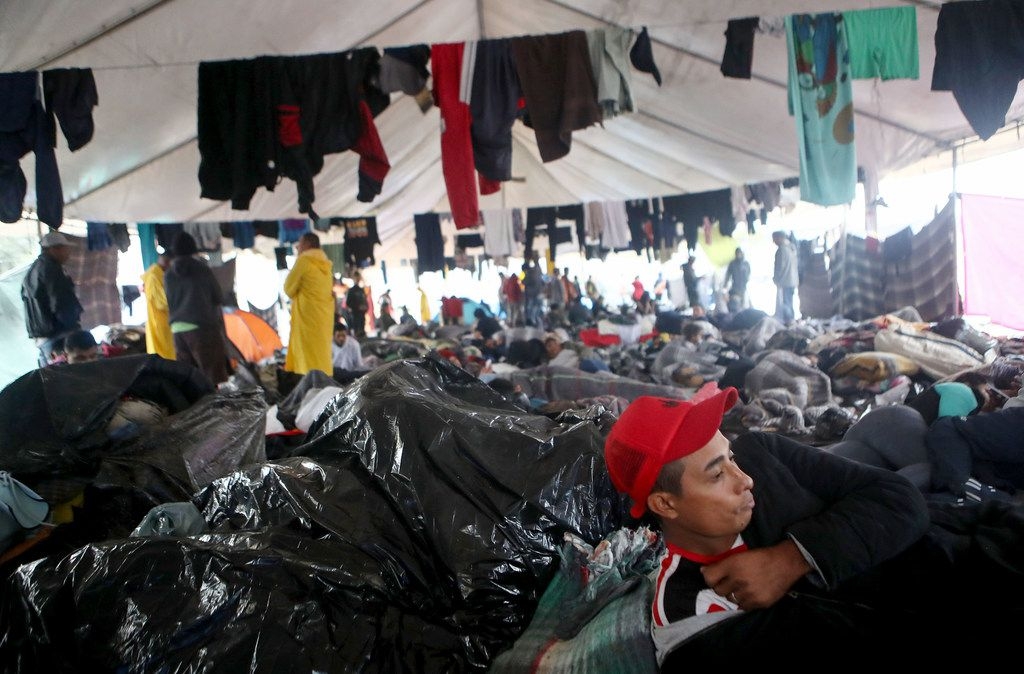 Migrants rested under a tent Thursday in a temporary shelter set up for migrants in Tijuana, Mexico.