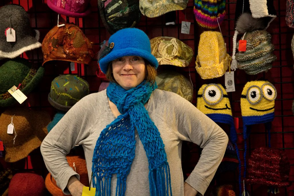 Knitter extraordinaire Kathy Davis models one of her playful creations at the Home Crafts store in Asheville's famed Grove Arcade.