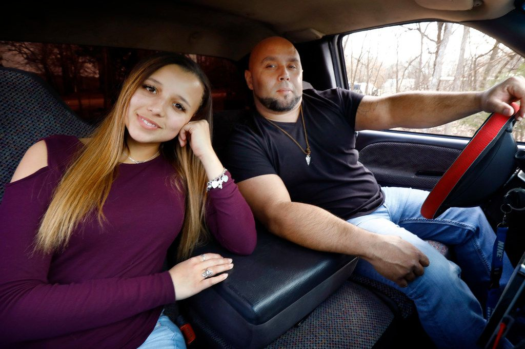 Country singer Kris Jones and his daughter Dayla pose together in the 1999 Dodge Ram pickup truck that made him a viral sensation last year at their Alvarado home on March 8, 2018. Jones is trying to parlay his viral fame into a country music career. (Tom Fox/The Dallas Morning News)