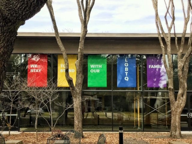 Banners hung at Greenland Hills United Methodist Church in Dallas express support for the congregation's LBGTQ members and family.