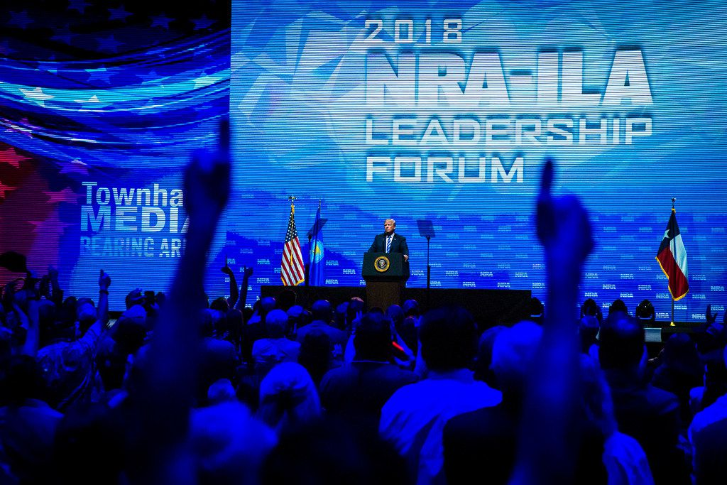 The audience cheers President Donald Trump as he addresses the NRA-ILA Leadership Forum at the Kay Bailey Hutchison Convention Center on Friday, May 4, 2018, in Dallas.
