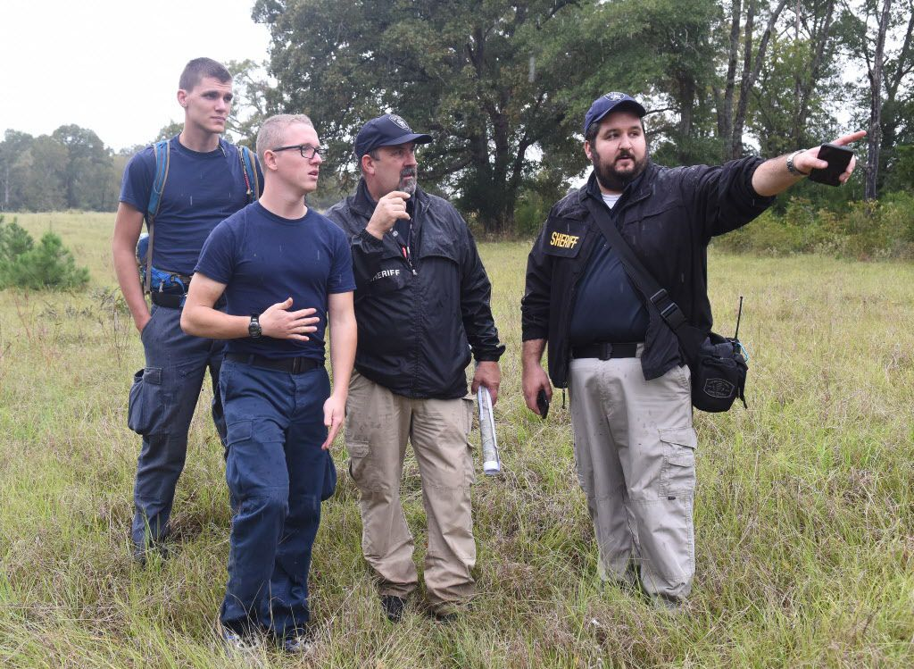 Samuel Kane and Sebastian Miggiani of the Alert Academy assist Smith County Sheriff's Office detectives Ron Rathbun and Justin Hall with organizing groups of volunteers for a public search for missing child Kayla Gomez-Orozco on Saturday morning, Nov. 5, 2016 in Bullard, Texas. Hundreds of people gathered at Bullard High School to join in the effort to find the missing 10-year-old.