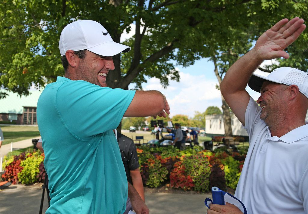 COLUMBUS, OHIO - AUGUST 18: Scottie Scheffler celebrates with his caddie, Scotty McGuinness, after winning the Korn Ferry Tour Nationwide Children's Hospital Championship at The Ohio State University Golf Club Scarlet Course on August 18, 2019 in Columbus, Ohio. (Photo by Matt Sullivan/Getty Images)