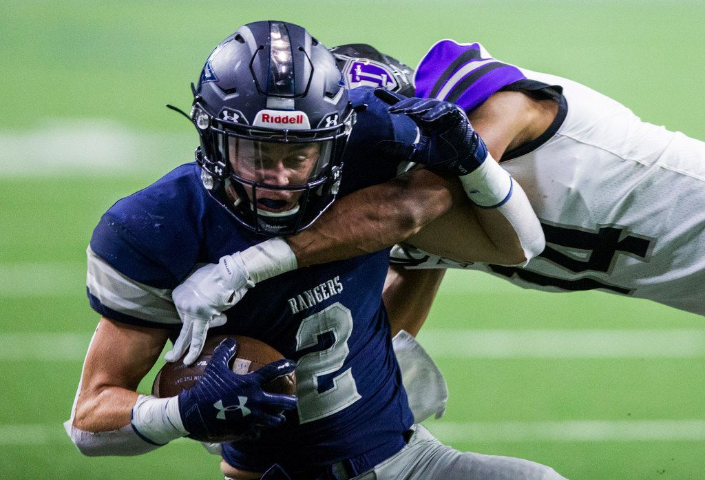 Frisco Lone Star wide receiver Jake Bogdon (4) is tackled by Frisco Independence defensive back Caleb Ellis (14) during the first quarter of a District 5-5A Division I high school football game between Frisco Independence and Frisco Lone Star on Thursday, October 10, 2019 at the Ford Center at The Star in Frisco. (Ashley Landis/The Dallas Morning News)