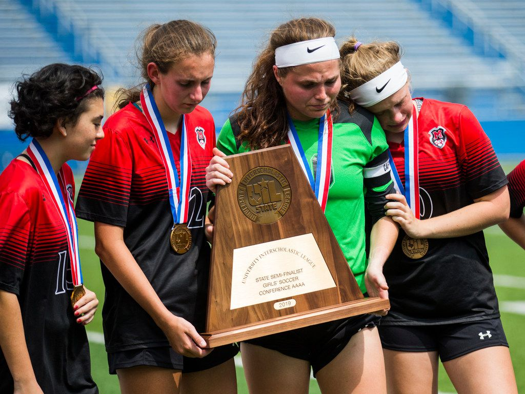 Melissa goalkeeper Brittany Morgan (20) and team mates react to receiving bronze metals and a third place trophy after a UIL conference 4A semifinal soccer game between Melissa High School and Liberty Hill High School on Wednesday, April 17, 2019 at Birkelbach Field in Georgetown, Texas. Melissa lost 2-1, and Liberty Hill will advance to the state final game. (Ashley Landis/The Dallas Morning News)