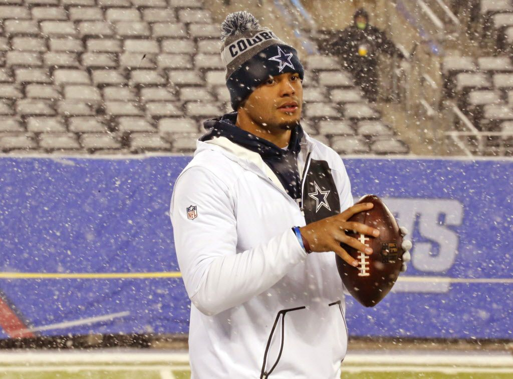 Dallas Cowboys quarterback Dak Prescott warms up in the snow during early pre-game warmups before the Dallas Cowboys vs. the New York Giants NFL football game at MetLife Stadium in East Rutherford, New Jersey on Sunday, December 11, 2016. (Louis DeLuca/The Dallas Morning News)