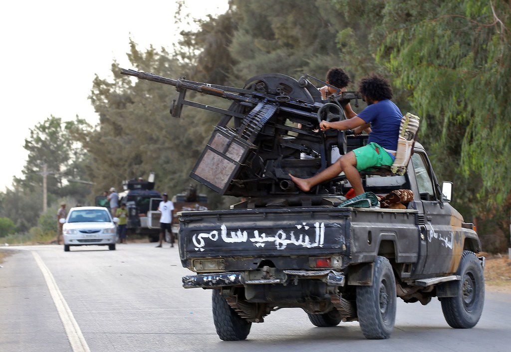 """Libyan militiamen loyal to the Government of National Accord, Libya's internationally recognised government, keep watch from a position south of the Libyan capital Tripoli on September 25, 2018. Libya's GNA has called on the UN to take """"concrete and effective"""" action to protect civilians and halt fighting near the capital that has killed more than 100 people since late August. The Libyan capital has been at the centre of a battle for influence between armed groups since dictator Moamer Kadhafi was ousted and killed in a NATO-backed uprising in 2011."""
