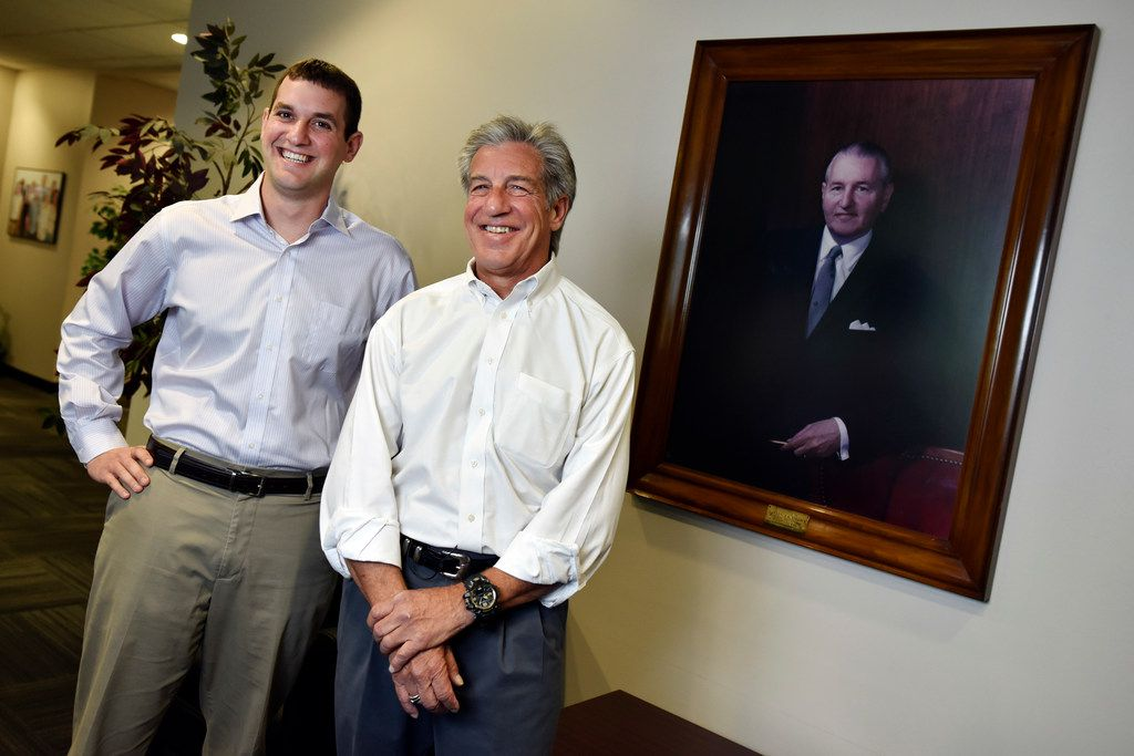 Lonnie Pollock IV, director of sourcing and supplies, and his father Lonnie Pollock III, CEO and president of Pollock, with a portrait of founder and grandfather Lawrence Pollock, at Pollock headquarters in Grand Prairie.