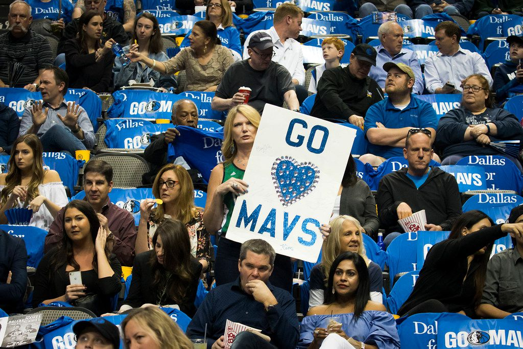 Dallas Mavericks fans cheer as their team warms up during the first half of the season finale against the Phoenix Suns at American Airlines Center on Tuesday, April 10, 2018, in Dallas.  The team has entered into a partnership with a Lithuanian blockchain company Lympo in which fans could turn tokens earned through exercise into tickets.