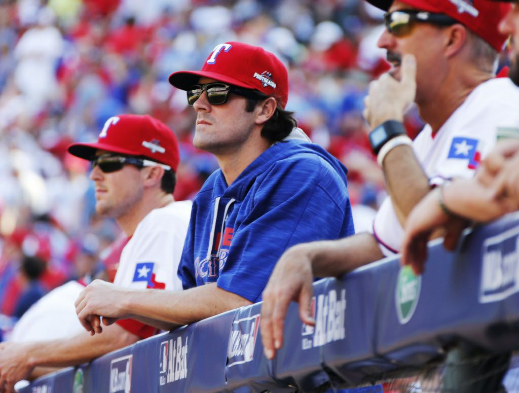 Texas Game 5 starting pitcher Cole Hamels, center, watches the action from the dugout during Game 4 of the ALDS between the Texas Rangers and the Toronto Blue Jays at Globe Life Park in Arlington, Texas on Monday, October 12, 2015. (Louis DeLuca/The Dallas Morning News)