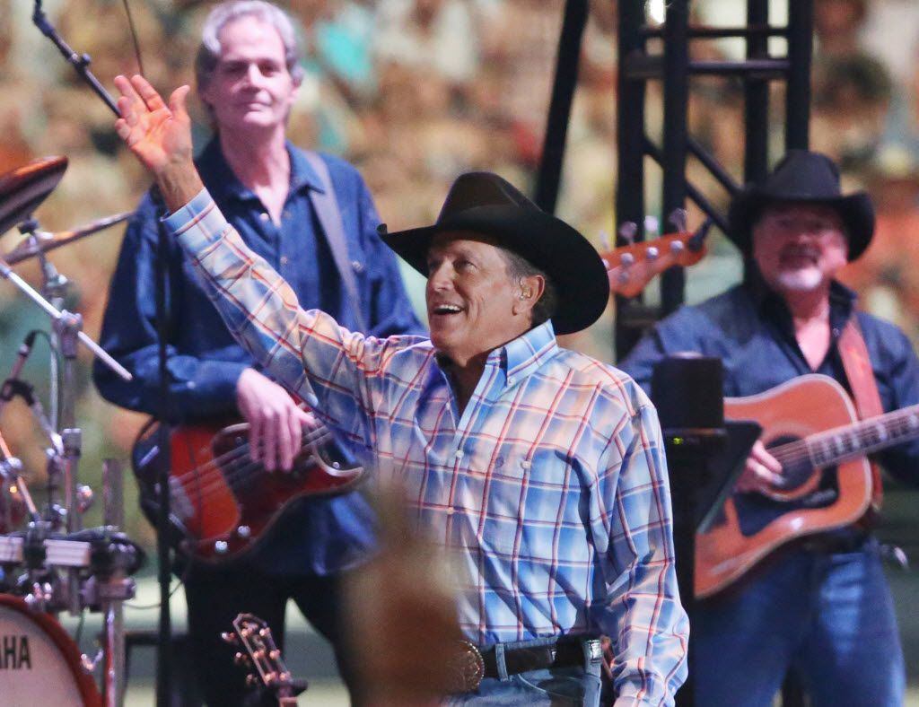 George Strait waves to the crowd as he plays the last show of his final tour at AT&T Stadium in Arlington, Texas on June 7, 2014. (Andy Jacobsohn/The Dallas Morning News) 06092014xARTSLIFE 11072014xNEWS