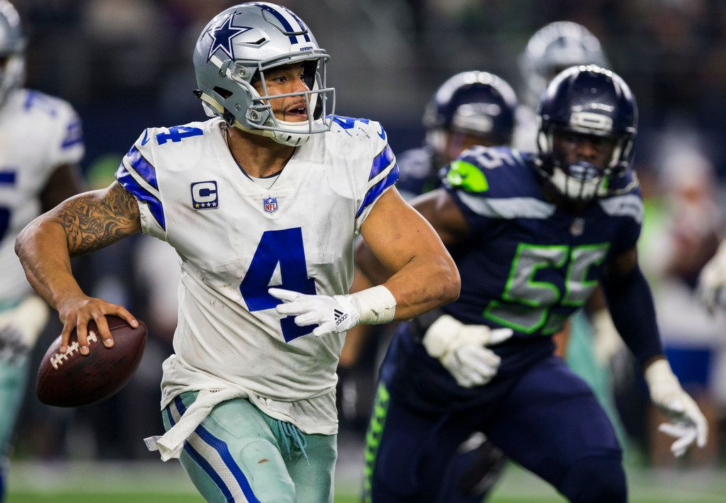 Dallas Cowboys quarterback Dak Prescott (4) scrambles to find a receiver during the fourth quarter of a Christmas Eve NFL game between the Dallas Cowboys and the Seattle Seahawks on Sunday, December 24, 2017 at AT&T Stadium in Arlington, Texas. (Ashley Landis/The Dallas Morning News)