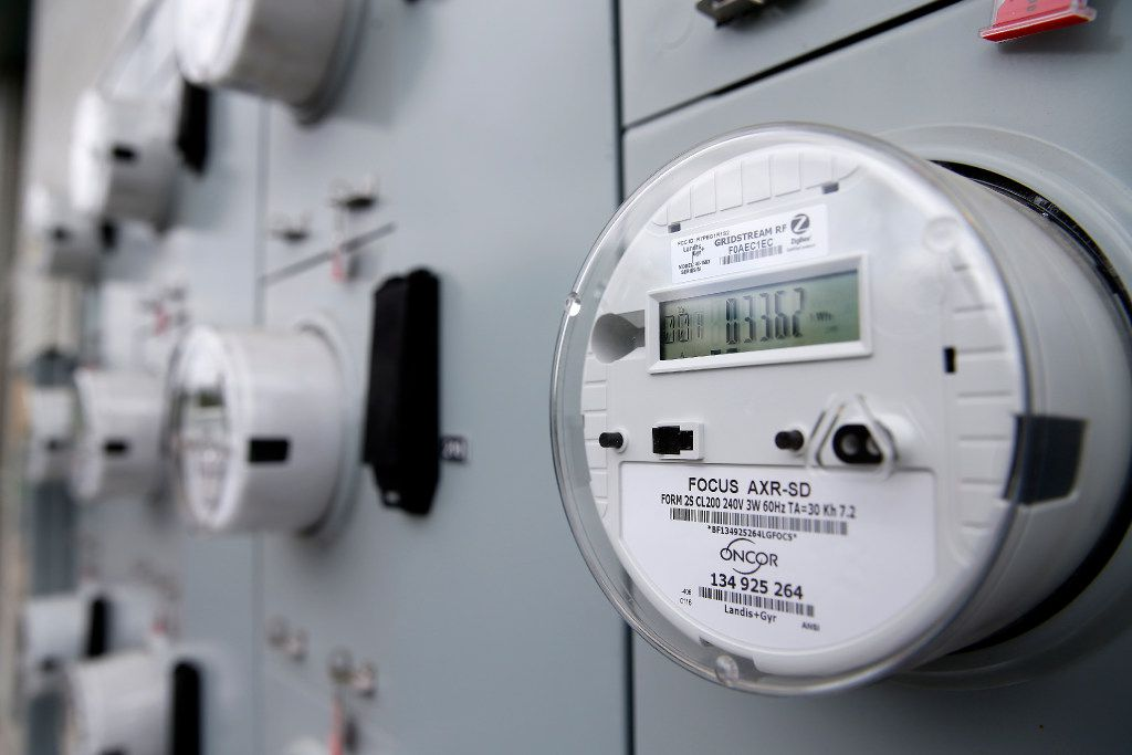 Electric meters are seen in the back of an apartment complex in Old East Dallas. Smart meters are allowing consumers to chose cheaper electricity plans.