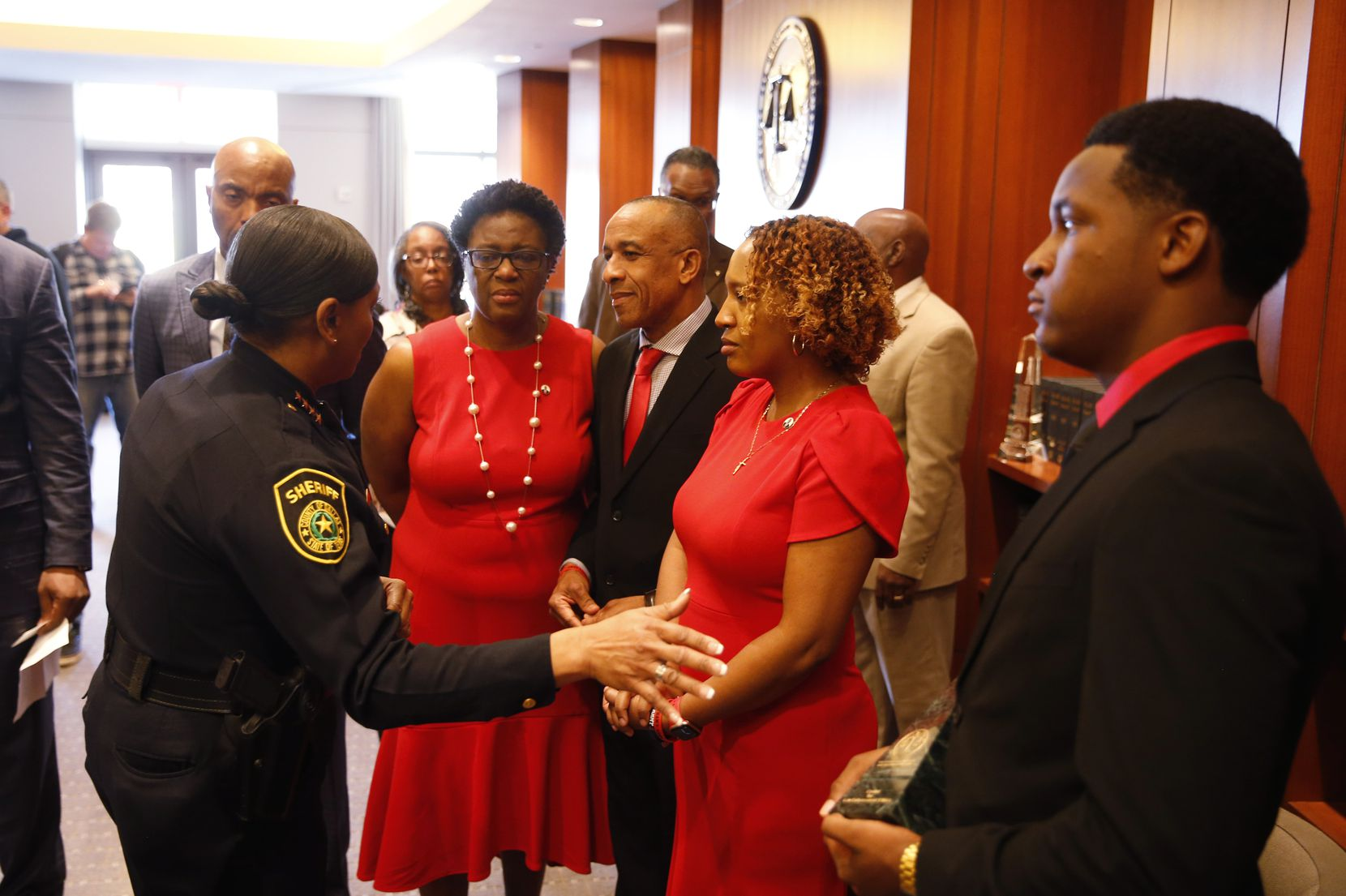 Dallas County Sheriff Marian Brown talks with the Jean family (from left) Allison Jean, Bertrum Jean, Allisa Findley and Brandt Jean on Tuesday after Botham Jean's younger brother received an award in Plano.