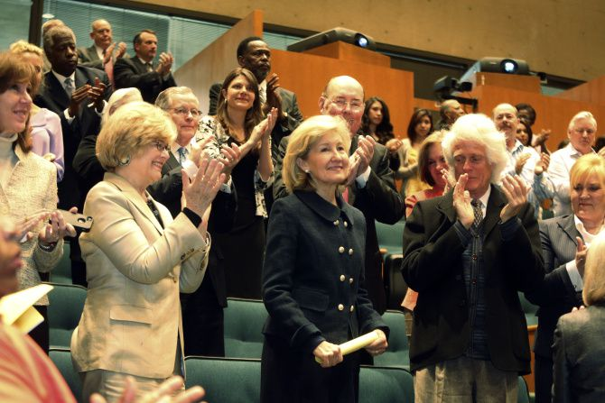 Dallas City Council members applauded former Senator Kay Bailey Hutchison at a meeting Wednesday.