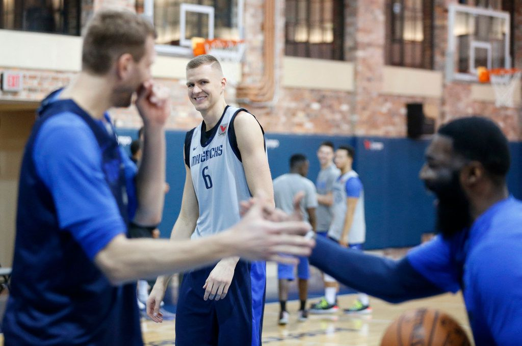 Dallas Mavericks forward Kristaps Porzingis (6) and Dallas Mavericks forward Dirk Nowitzki (41) share a laugh during practice at American Airlines Center in Dallas on Monday, February 4, 2019. (Vernon Bryant/The Dallas Morning News)