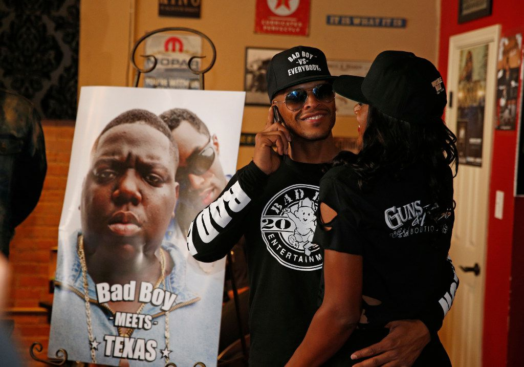 Kai Williams (left) and Christina Puga greet one another at pop-up store featuring Bad Boy products at  Guns and Roses Boutique in Dallas, TX Sept. 14, 2016.