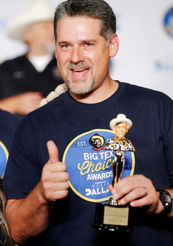 "Tom Grace celebrates winning both the ""Most Creative"" and ""Best Taste - Savory"" categories for his ""Funnel Cake Bacon Queso Burger"" during the The Big Tex Choice Awards at Fair Park in Dallas, Sunday, August 27, 2017. (Brandon Wade/Special Contributor)"