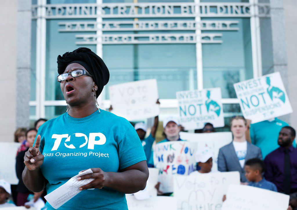 Community Organizer Monica Lindsey with the Texas Organizing Project speaks out against suspensions in the Dallas Independent School District. (Brandon Wade/Special Contributor)